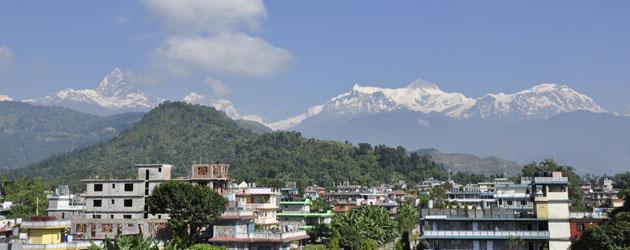View from our hotel rooftop of the Himalaya's. We trekked the Annapurna circuit around them....  ネパール、ポカラのゲストハウスの屋上からヒマラヤ連峰のひとつアンナプルナ山脈を臨む。ここからアンナプルナ・サーキットを廻る2週間のトレッキングに出発