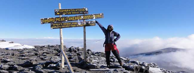 Megumi at the highest peak of Kilimanjaro (5895m), Scott had to turn back on the final ascent with AMS.