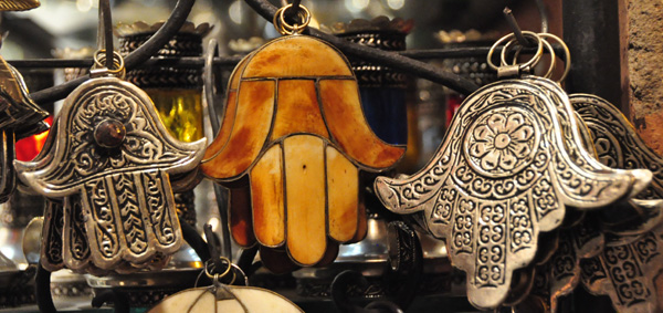 The Hamsa, a protection amulet used to ward off the evil eye (also known as Fatimah's hand) - one of many tantalising symbols that define travel across Morocco the Middle East.