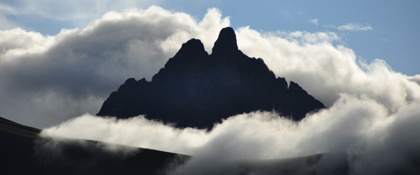 "The Sacred mountain of ""Apu Yanantin"", revered by the Andean people and said to symbolize the union of two dissimilar energies.... The mountain sits high above the magnificent Incan fortress and ruins of Ollantaytambo, a beautiful atmospheric Incan village wedged between fantastic mountain ruins on either side...."