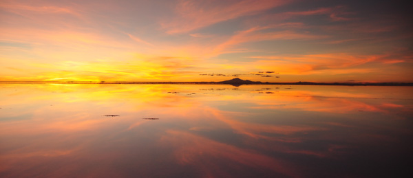 The sunset over Uyuni was particularly amazing, quite psychedelic. A cascade of colours erupting in front, under and all around you. To see it we had to stay in a very basic hotel (made of salt) in the middle of the lake. Primitive accommodation, freezing cold at night - but the only guests with the entire salt scape to ourselves.